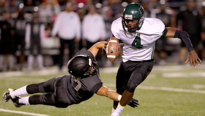 Cordova quarterback Devin Coleman, right, evades a tackle from Houston's Jake Christoffersen, left, during their game at Houston High School.