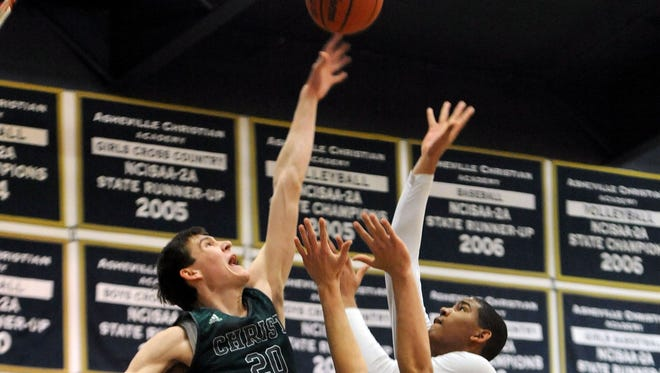 Christ School senior John Fulkerson (20) now has 18 Division I scholarship offers.