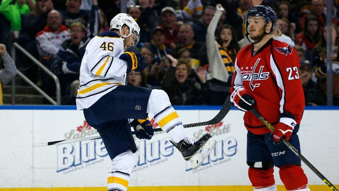 Buffalo Sabres defenseman Cody Franson (46) celebrates after scoring a goal as Washington Capitals left wing Zach Sill (23) reacts during the second period at First Niagara Center.