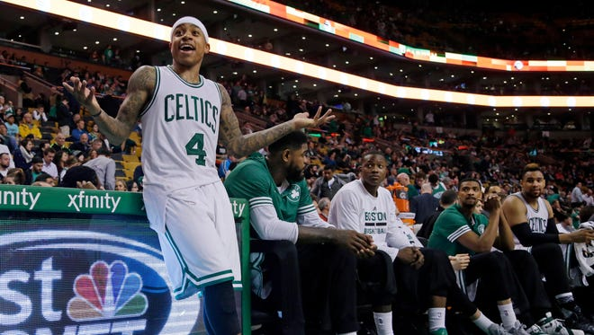Boston Celtics guard Isaiah Thomas (4) gestures from the bench to a fan in the fourth quarter of an NBA basketball game against the Milwaukee Bucks, Thursday, Feb. 25, 2016, in Boston.