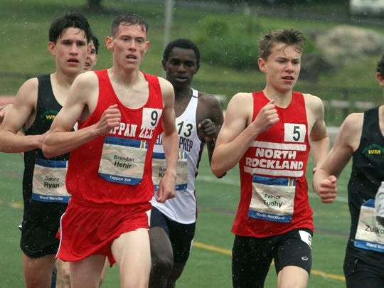 Brendan Hehir of Tappan Zee and Patrick Tuohy of North Rockland compete in the Loucks Mile during day 3 of the 50th annual Loucks Games at White Plains High School May 13, 2017.