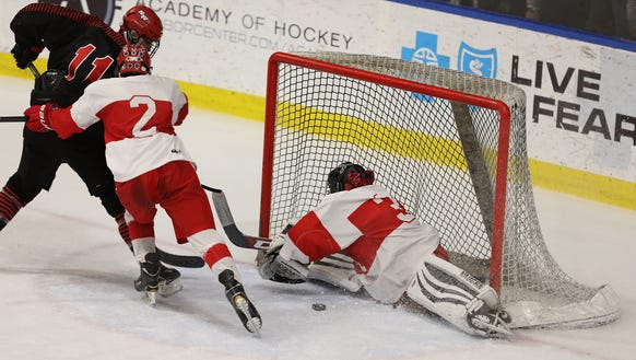 North Rockland goalie Angelo Zodda stops the puck while