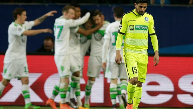 Gent's Kenny Saief reacts after Wolfsburg scored during the Champions League round of sixteen 2nd leg soccer match between VfL Wolfsburg and KAA Gent in Wolfsburg, Germany, Tuesday, March 8, 2016. (AP Photo/Michael Sohn)