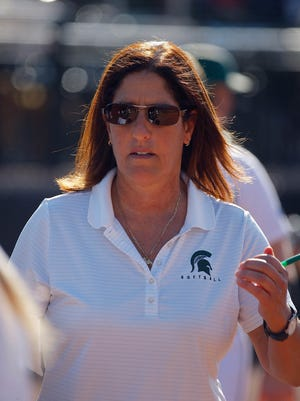 Michigan State head coach Jacquie Joseph walk along the dugout against Indiana Friday, April 15, 2016, in East Lansing.