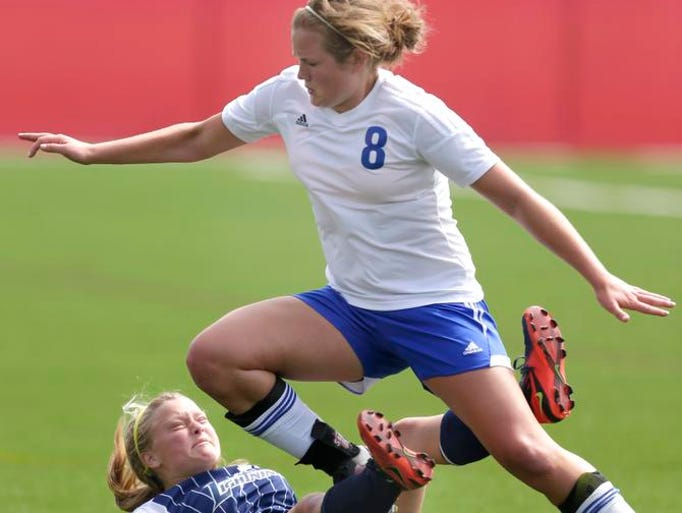 Assumption High School's #8 Mary Sigler against Lake Country Lutheran Co-op's #17 Sammie Sabol during WIAA Division 4 state tournament action on June 19, 2014 in Milwaukee, Wis.