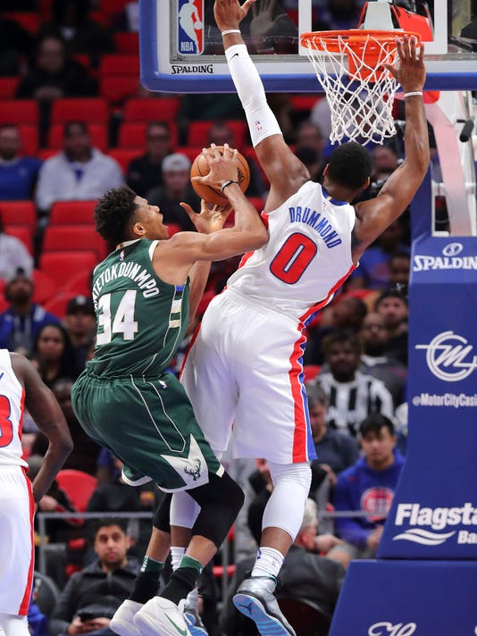 Milwaukee Bucks forward Giannis Antetokounmpo (34) drives on Detroit Pistons center Andre Drummond (0) during the first half of an NBA basketball game in Detroit, Wednesday, Feb. 28, 2018. (AP Photo/Paul Sancya)