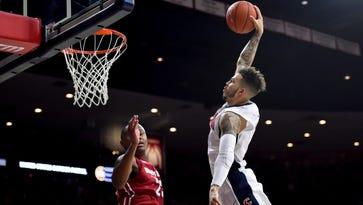 Jan. 16, 2016; Tucson; Arizona Wildcats guard Gabe York (1) dunks tas Washington State Cougars guard Charles Callison (23) defends during the second half at McKale Center. Arizona won 90-66.