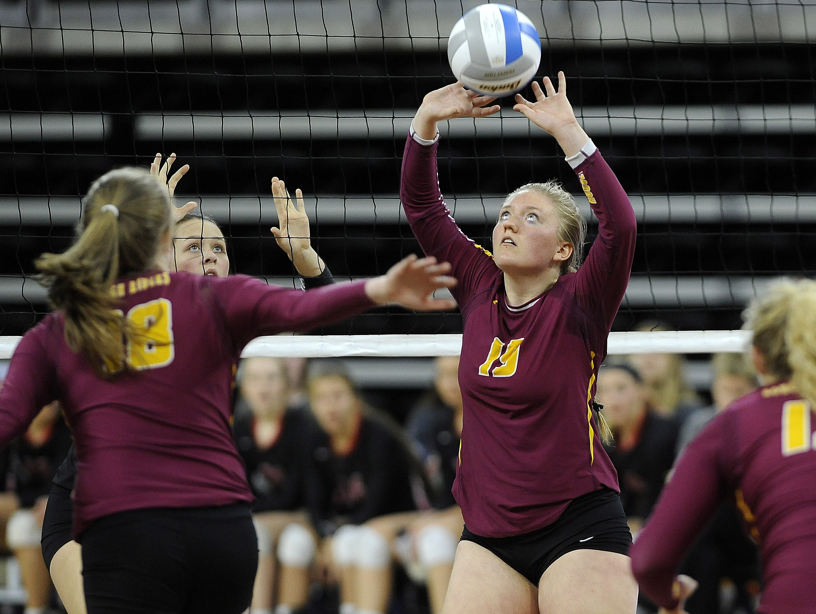 Roosevelt's #19 Bailey Lamb sets the volleyball against Brandon Valley during state volleyball action at the Denny Sanford Premier Center in Sioux Falls, S.D., Thursday, Nov. 19, 2015.