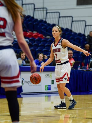 USI's Randa Harshbarger (3) communicates with her team as she prepares to advance the ball down the court during the first quarter against the Missouri Science and Technology Miners at USI's Physical Activities Center in Evansville, Ind., Thursday, Jan. 18, 2018.