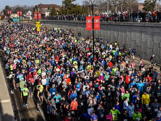 Runners get ready for the start of the Earth Day Half