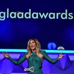 Actress Laverne Cox hosted the GLAAD Media Awards at the Waldorf Astoria in New York Saturday. Here she is in one of her three immaculate outfits: a green Michael Costello gown with sleeves.