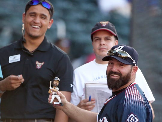 Reno Aces first baseman Cody Decker shows a bobblehead of himself from Chihuahuas employee Darryl Shukitt, left, to a teammate before the El Paso Chihuahuas-Reno Aces game in April 2018 at Southwest University Park. Decker was a popular player in El Paso, when he played two seasons with the El Paso Chihuahuas.