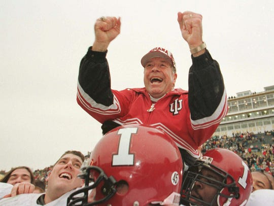 Indiana head coach Bill Mallory was carried off the field after beating Purdue in West Lafayette in 1996.
