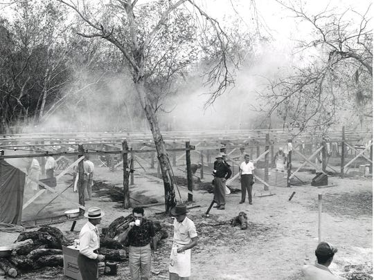 An army of volunteers and professional cooks prepared 9,000 pounds of barbecue for the dedication of Wesley Seale Dam in April 1958.