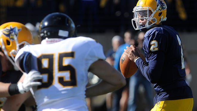 Augustana's #2 Trey Heid looks for an open teammate against Wayne State during football action at Kirkeby-Over Stadium in Sioux Falls, SD; Saturday, Oct. 17, 2015.