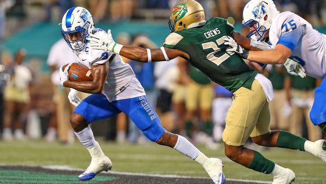 MTSU wide receiver Richie James escapes a UAB defender at Legion Field on Oct. 14, 2017.