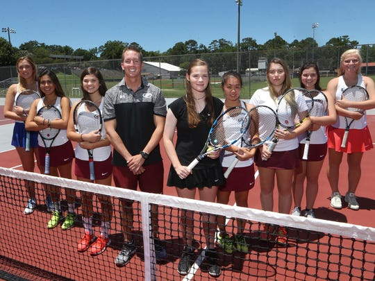 The 2017 All-Big Bend girls tennis first team. From left: Daniela Schneider (Maclay), Sofia Guerrero (Chiles), Gracie Wilson (Chiles), Coach of the Year Owen Long (Chiles), Player of the Year Laura Ceci (NFC), Ashley Tang (Chiles), Estella Waczewski (Chiles), Anna Vinson (Chiles), Jules Grady (Leon).