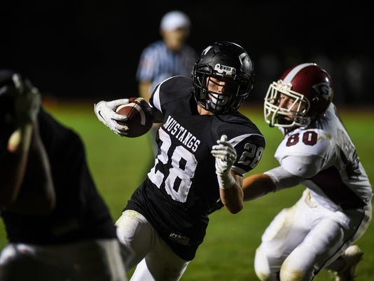 South Western's Andrew Hartlaub carries the ball while Gettysburg's Michael Ingalsbe defends on Friday Aug. 29, 2014 at South Western. Shane Dunlap - GameTimePA
