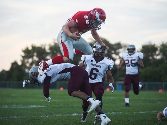 Bermudian Springs' Phoenix Russell leaps over a Shippensburg defender while trying to deliver the ball further down field on Friday Sept. 12, 2014 at Bermudian Springs High School. Shane Dunlap - GameTimePA