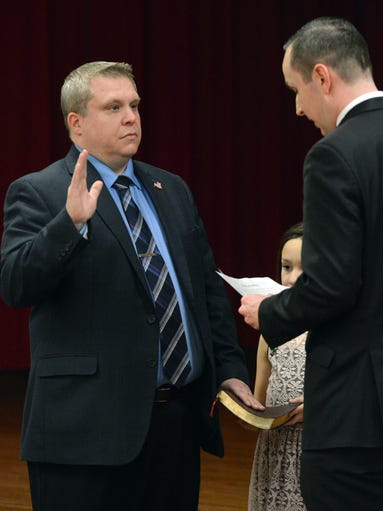 David Uhl, left, takes his oath of office as Lancaster