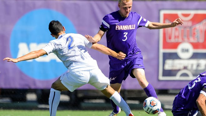 University of Evansville's Simon Waever (3) kicks the ball past Fort Wayne's Carmelo Morales (2) during the ProRehab Aces Soccer Classic at Arad McCutchan Stadium, Sunday, Sept. 11, 2016. UE beat Fort Wayne 3-1.