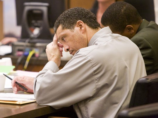 Mark Goudeau sits at the defendant's table during his trial for rape in Phoenix in July 2007.