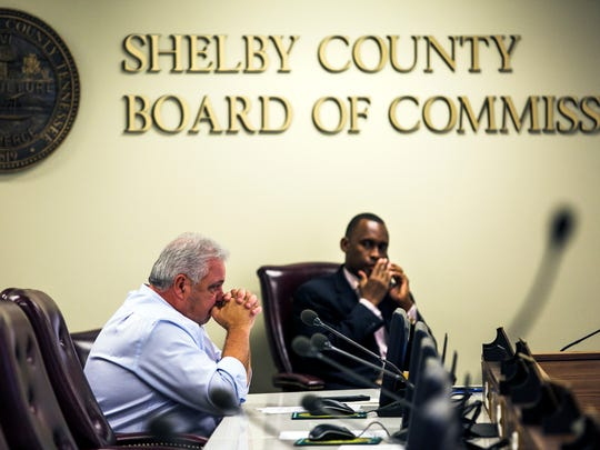 "Shelby County Commissioner Terry Roland listens to a speaker during the general government committee to discuss HR policies after the Facebook post of a former county deputy director that were supportive of the KKK surfaced. The social media policy for Shelby County government states that it ""expects all employees and public officials to demonstrate the highest degree of integrity, responsibility, and professional conduct at all times."""