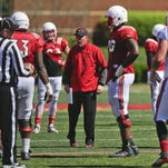 "Louisville head coach Bobby Petrino yells at his squad during Spring scrimmage Saturday. ""Last part of the scrimmage was really about toughness,"" Petrino said. ""We try to run the ball every snap and let our players understand that, at some point in the fourth quarter, you're going to have to run the ball to win, or stop it to win."" By Matt Stone, The C-J April 11, 2015."
