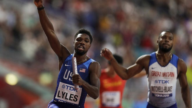 Noah Lyles celebrates leading the U.S. to gold in the men's 4x100 relay final at the world championships in Doha, Qatar, in 2019.