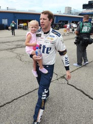Brad Keselowski, with his daughter last year at MIS, is seeking his first win at the Michigan track.