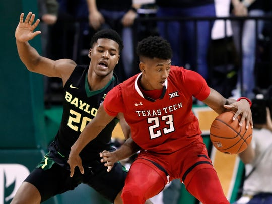 Baylor's Jared Butler, left, defends as Texas Tech guard Jarrett Culver (23) works for a shot opportunity during the second half of an NCAA college basketball game Saturday, Jan. 19, 2019, in Waco, Texas. (AP Photo/Tony Gutierrez)