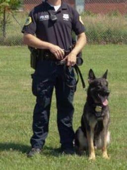 Sgt. Ron Kouski and his police dog, Cak (pronounced Zack)