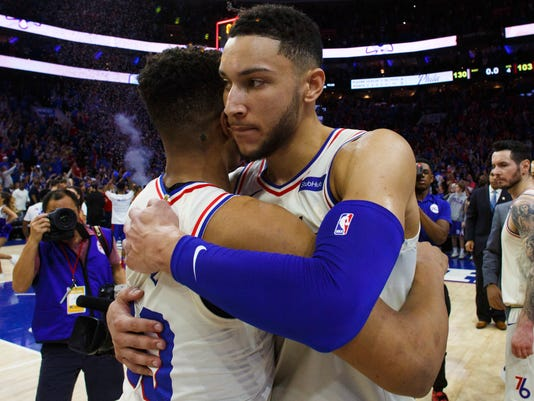 Philadelphia 76ers' Ben Simmons, right, gives Markelle Fultz a hug after Game 1 of the team's first-round NBA basketball playoff series against the Miami Heat, Saturday, April 14, 2018, in Philadelphia. The 76ers won 130-103. (AP Photo/Chris Szagola)