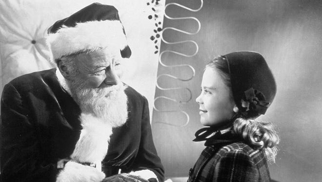 """Edmund Gwenn (left, with a young Natalie Wood), plays Kringle in the 1947 classic """"Miracle on 34th Street."""""""