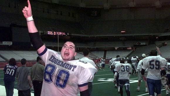 Matt Bernstein signals the crowd that the game is over and the Panthers have won the Class C State Championship for a second time, 1998. Bernstein, a two-time Super 11 pick, was followed by his brother Ben Bernstein, who was named Super 11 in 2003.
