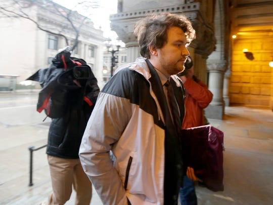 CLARKE - Dan Black enters the TheMilwaukee FederalBuilding and U.S.CourthouseonE. Wisconsin Ave, in Milwaukee on Monday, January 22, 2018 before a civil rights trial over former Milwaukee County Sheriff David A. Clarke. Black says Clarke infringed on his free speech rights after an airport encounter.  - Photo by Mike De Sisti  / Milwaukee Journal Sentinel