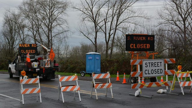 River Road S remains closed after a mudslide caused a car to rollover onto its top Tuesday, shutting down traffic in the area.
