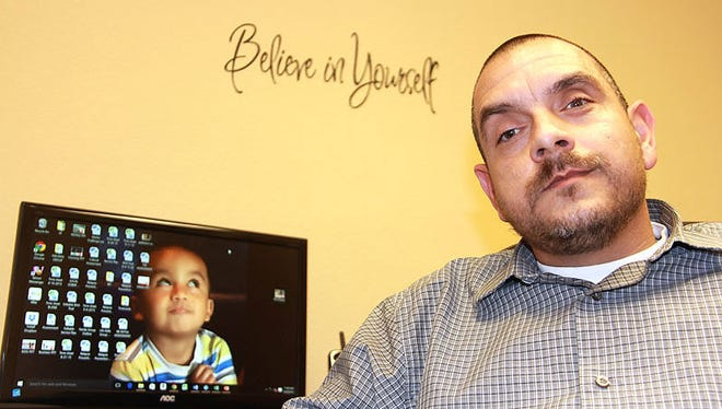 Rick Reyes, shown in his office, is the lead behavioral health technician at Recovery Oasis in Tempe.