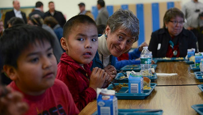 """Interior Secretary Sally Jewell shares lunch with students at Cove Day School, one of two Navajo Nation schools that got """"long overdue"""" federal funds for renovation."""