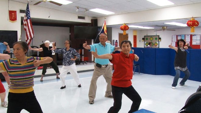 Members of the Chinese Senior Center participate in line dancing, one of the activities provided at the Phoenix center.