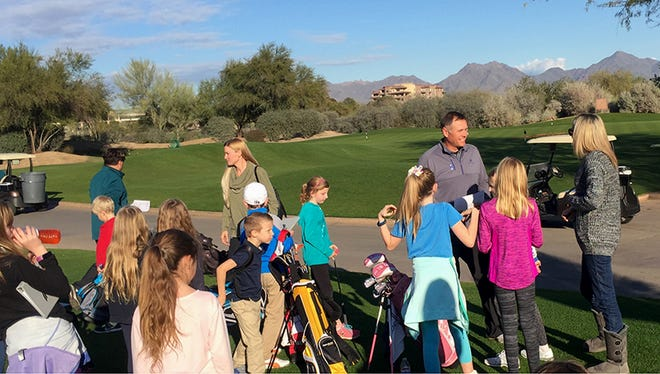 Dale Balvin works with young golfers as part of his Golf's Elementary program, an after-school program for kids 5-14.