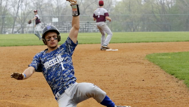 Nico Limoncelli of Horseheads slides safely into third last season against Elmira.