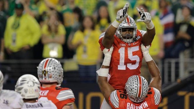 Ohio State running back Ezekiel Elliott (15) celebrates following a touchdown during the second half of the NCAA college football playoff championship game against Oregon Monday, Jan. 12, 2015, in Arlington, Texas. (AP Photo/Eric Gay)