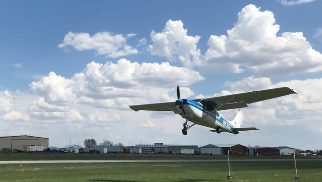 A plane rented by Sioux Falls Realtor Amy Stockberger takes off from the Tea airport, pulling a banner into the sky asking homeowners to sell.