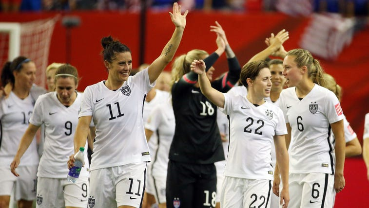 United States team members wave to the crowd after