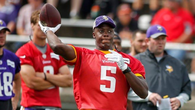Aug 1, 2016; Mankato, MN, USA; Minnesota Vikings quarterback Teddy Bridgewater (5) passes at training camp at Minnesota State University.
