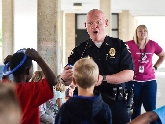 "Marion Police Lt. B.J. Gruber, Officer Dave Dunaway and the ""Chillers"" volunteers visited the Marion Boys and Girls Club to give out freeze pops in July 2016."
