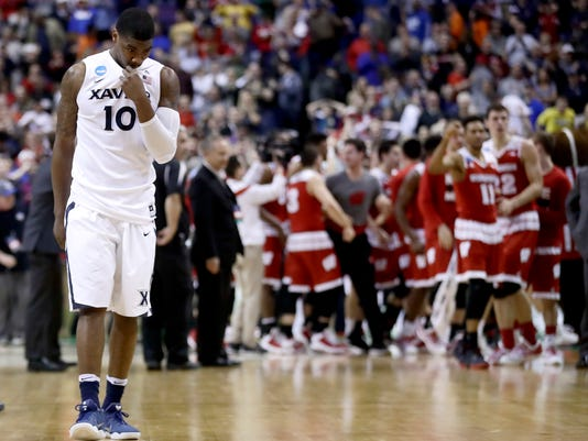 Xavier's Remy Abell walks off the court after losing a second-round men's college basketball game against Wisconsin in the NCAA Tournament, Sunday, March 20, 2016, in St. Louis. Wisconsin won the game 66-63. (AP Photo/Charlie Riedel)