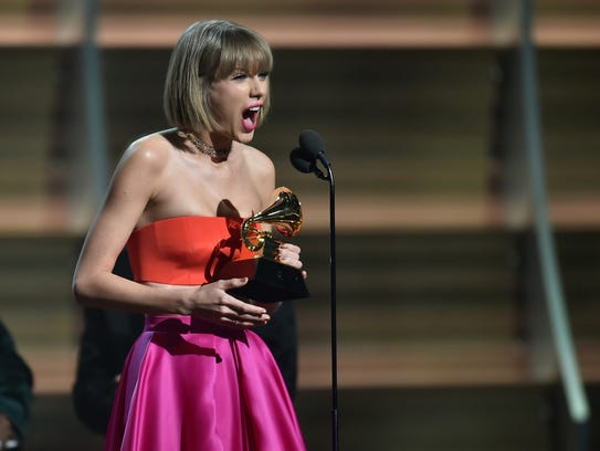 Taylor Swift exults after winning album of the year