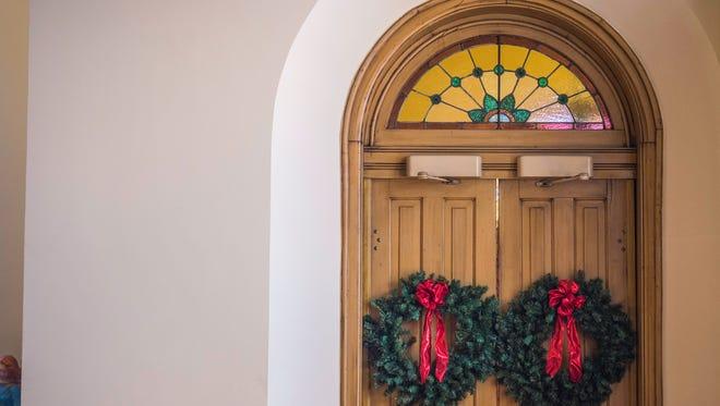 Wreaths hang on a doorway inside the sanctuary of First Presbyterian Church, 100 N. 10th St., Richmond, on Tuesday, Dec. 12, 2017.